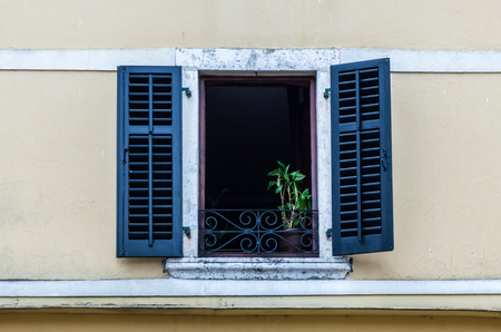Wooden window with louvers in old house in the Kotor, Montenegro photo