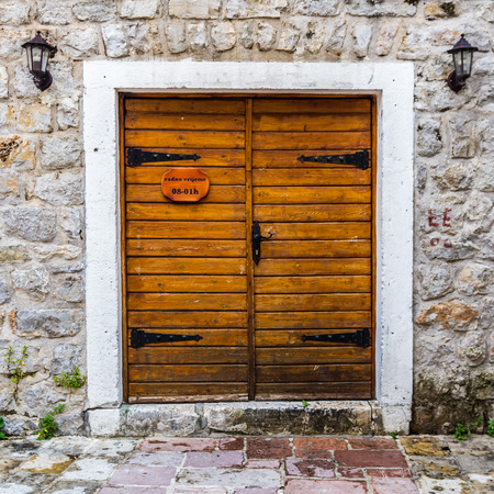 Wooden door in old house in Budva, Montenegro photo