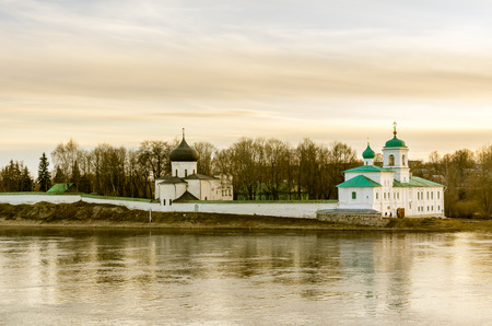 evening church: Landscape evening view on church on the coast of river in Pskov, Russia. Toned photo.