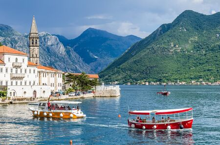 old town guildhall: PERAST, MONTENEGRO - JUNE 28: View on boats and Kotor bay on June 28, 2015 in Perast, Montenegro Editorial