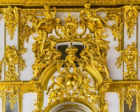 pushkin: Closeup view on gold interior details in Catherine Palace in Tsarskoye Selo (Pushkin), Russia