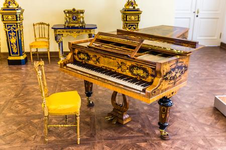 selo: Antique grand piano in Catherine Palace in Tsarskoye Selo (Pushkin) in Russia