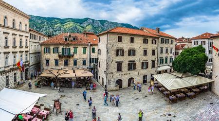KOTOR, MONTENEGRO - JUNE 18: People walking on old town street at sunny day at June 18, 2014 in Kotor, Montenegro
