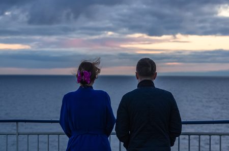 baltic people: Two people looks on sunset on the Baltic sea from cruise ship