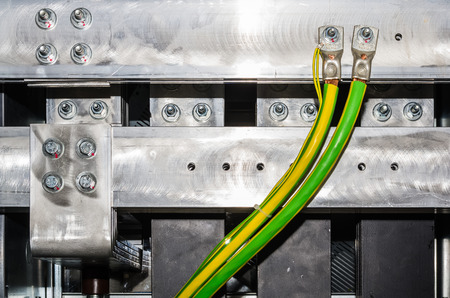 amperage: Closeup view on aluminum bars in electrical switchgear