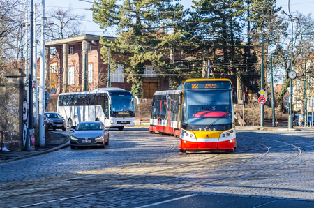 PRAGUE, CZECH REPUBLIC - FEBRUARY 15: Modern tram rides down the street at February 15, 2019 in Prague, Czech Republic