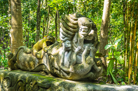 Monkey sculpture in sacred Monkey Forest park, Ubud, Bali, Indonesia