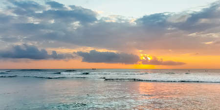 Amazing sunset view on Indian ocean from Suluban beach at Bali, Indonesia