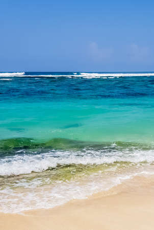 Day view on Indian ocean and Karma beach with white sand on Bali, Indonesia