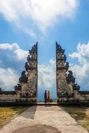 BALI, INDONESIA - SEPTEMBER 18: Tourists take photos at the gates of Pura Lempuyang Luhur Temple at September 18, 2018, Bali, Indonesia Editöryel