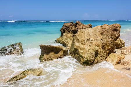 Day view on Indian ocean, stones and rocks on Karma beach with white sand on Bali, Indonesia Stok Fotoğraf