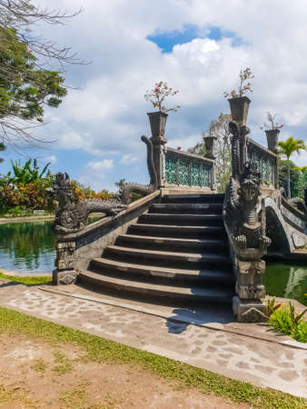 View of bridge in park in Tirta Gangga temple at sunny day in Bali, Indonesia Stok Fotoğraf