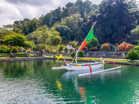 BALI, INDONESIA - SEPTEMBER 18: View of boat in pond in Tirta Gangga temple at September 18, 2018 in Bali, Indonesia