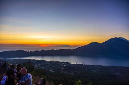 UBUD, BALI, INDONESIA - SEPTEMBER 12: Tourists greet sunrise on summin of Batur volcano at September 12, 2018 in Ubud, Bali, Indonesia Editöryel