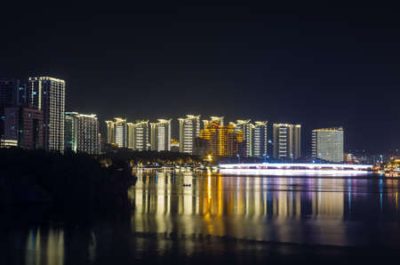 Scenic night cityscape view of Sanya city on Hainan island, China