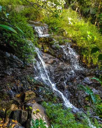 Waterfall and mountaina river in the Yanoda Rainforest Cultural Tourism Zone, Hainan, China Reklamní fotografie