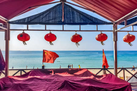 Colorful traditional chinese red lanterns on palm background in the Sanya, Hainan, China