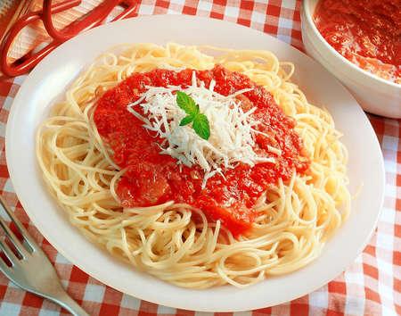 spaghetti dinner: Spaghetti with tomato sauce and cheese Stock Photo