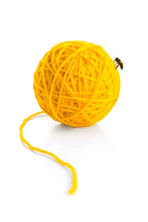 proving: 100% PURE WOOL - Ball of wool with a bee on it, proving that it is pure wool. Stock Photo
