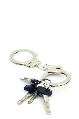 CONFISCATION OF PROPERTY - Property-keys confiscated using handcuffs.