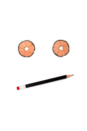 CONFUSED - An emoticon showing doubt, made by the savings of a pencil, thus creating the eyes, and a pencil for mouth. Zdjęcie Seryjne