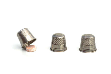 GAMBLING LIFE WITH DRUGS - Three thimbles and one pill mimicking the shell game, implying the life risk of drug abuse.