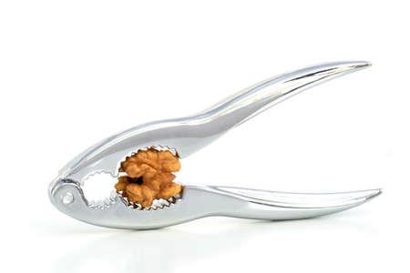 HEADACHE - A nutcracker pressing the kernel of a walnut, instead of the walnut. Zdjęcie Seryjne