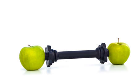 HEALTHY WEIGHT LIFTING - An allegory for consuming apples to get in good shape. Zdjęcie Seryjne