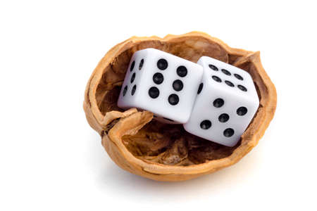 probability: LUCK IS UNCERTAINTY - Two dices in a nutshell on a journey for luck. Stock Photo