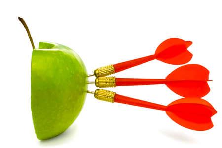 TRIPLE BULLSEYE 4 - Three red darts-arrows hit a half cut green apple.