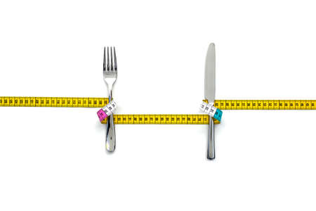ON A DIET 3 - A fork  and knife wrapped with a measure with empty space in between for text.