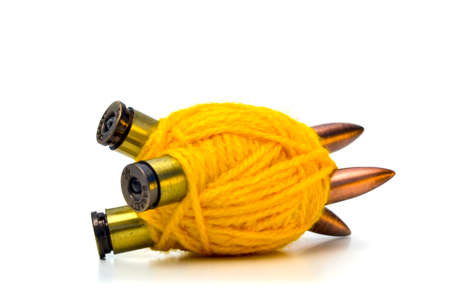 pacifism: PACIFISM DISARMAMENT 3 - Three bullets wrapped with thread of wool. Stock Photo