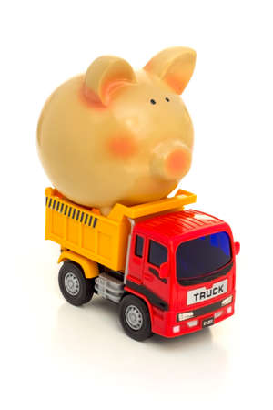 TAKE THE MONEY AND RUN - A piggy-bank is loaded on a toy-truck.