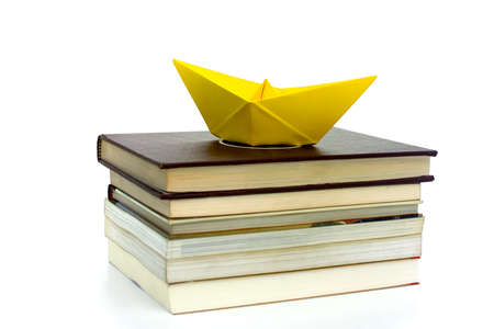 WITH A BOOK YOU CAN TRAVEL 1-An origami boat shipping through the books.
