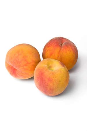 Peaches isolated on white background photo