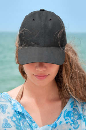 baseball caps:  Girl with black baseball cap and curly hair Stock Photo