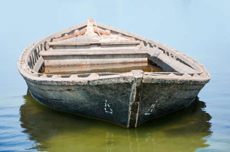 Old fishing boat floating on the water photo