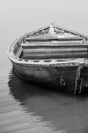 Old fishing boat in black and white photo