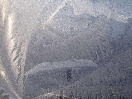 Frosty natural pattern on winter window. Background. photo