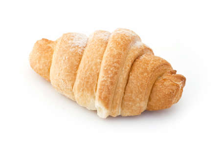 Single fresh croissant, casting soft shadow on white. photo