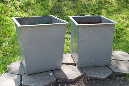 Two trash cans in the park photo