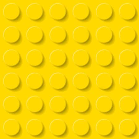 黄色のプラスチック製の建設キット背景を抽象化します。