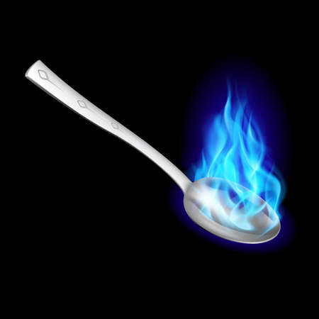 alight: Metal spoon with blue fire on black background.