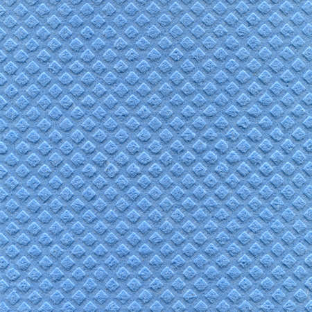 Cellulose sponge cloth texture in blue as background. photo