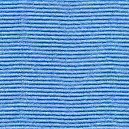 corrugate: Cellulose sponge cloth texture in blue color as background.