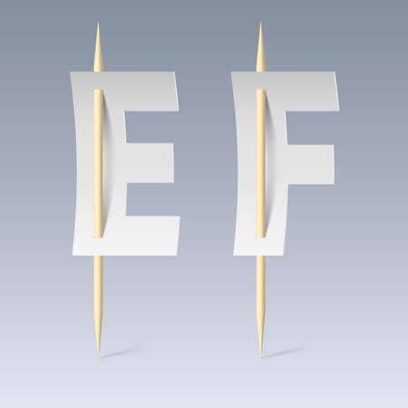 pierce: White paper cut font on toothpicks on grey background. E and F letters