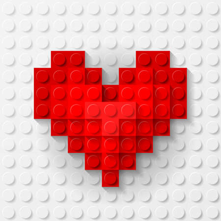14: Plastic red heart on white background made of construction kit