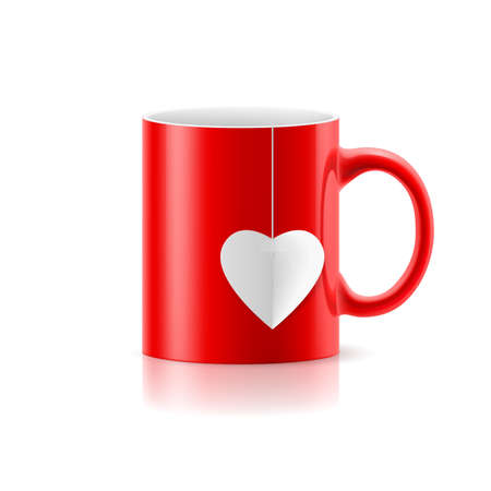 teabag: Red cup with teabag in the form of heart