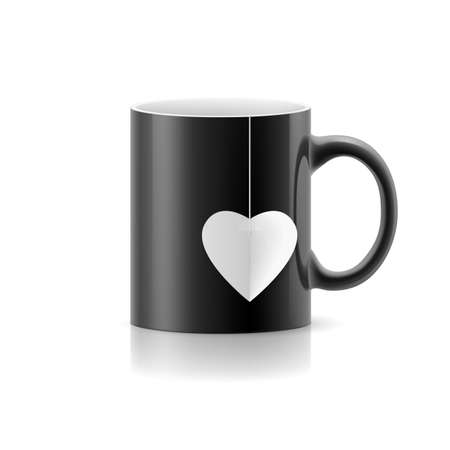 teabag: Black cup with teabag in the form of heart