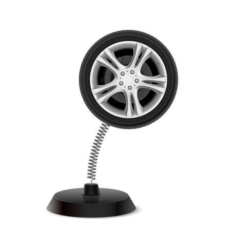 knickknack: Table souvenir in form of car wheel on spring